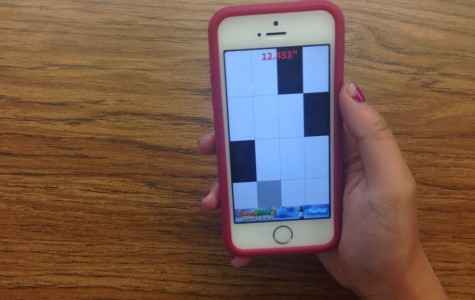 A Carlmont High School student plays the new app, Don't Tap the White Tile.