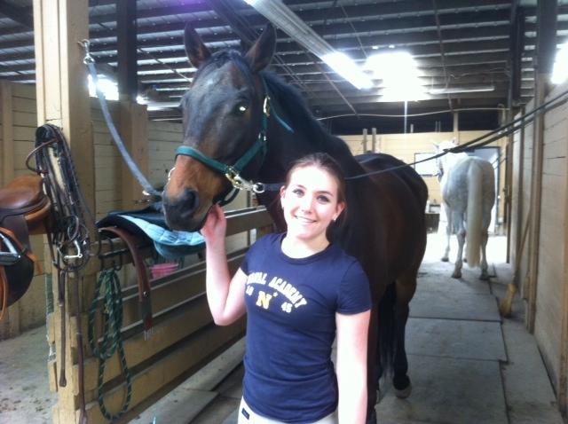 Senior Lauren Livengood with her horse Eustace.