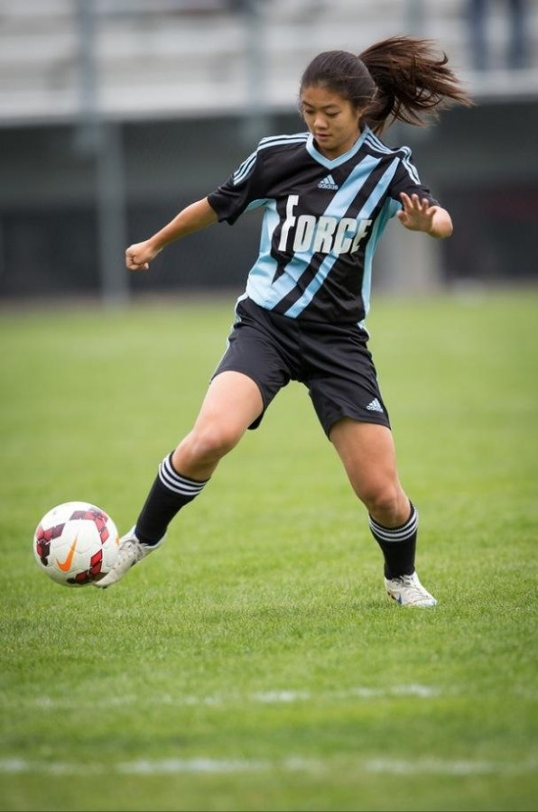 Action shot of Fong taken for her club soccer team, De Anza Force.