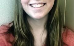 Tara Callan happily smiles.