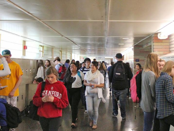 Students make their way through the crowd during passing period.