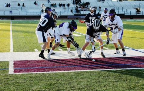 Carlmont and Sequoia battle for the ground ball.