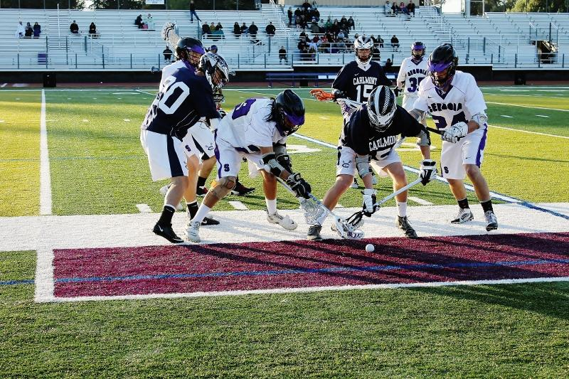 Carlmont+and+Sequoia+battle+for+the+ground+ball.