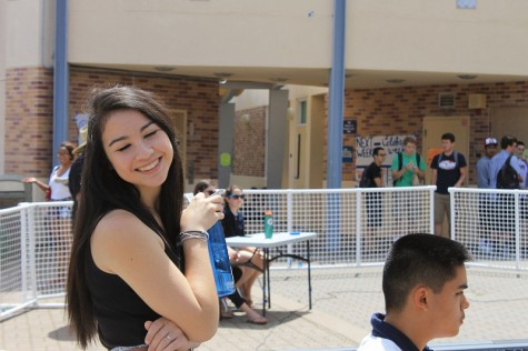 ASB spirit commissioner Alenna Winfield helps to supervise the talent show as the contestants perform.