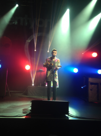 The lead singer, Tyler Joseph performing with a ukulele.