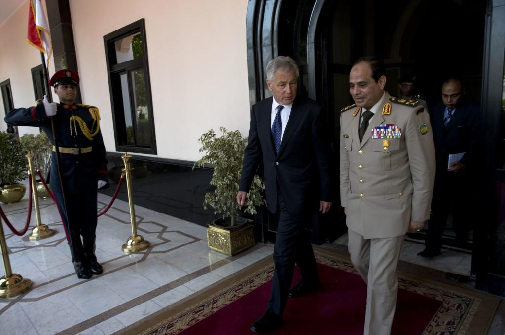 Presidential candidate Abdel Fattah al-Sisi walks alongside United States Secretary of Defense Chuck Hagel in Cairo, Egypt. Image courtesy of Creative Commons Search.
