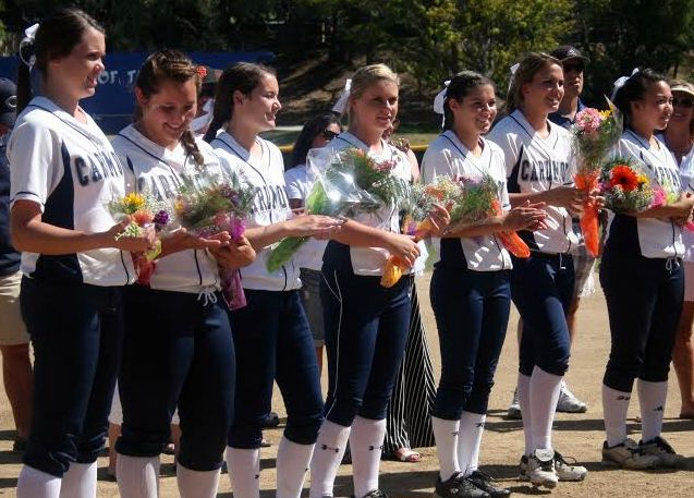 (From left to right,) Rebecca Faulkner, Gabriella Pons, Danielle Giuliacci, Christy Peterson, Missy Pekarek, Katelyn Bacciocco, and Madi Chang all smiled with their flowers on senior day.