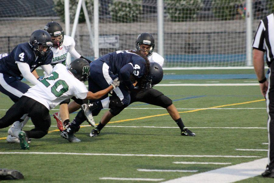 Senior Willie Teo fights back in an offensive play.