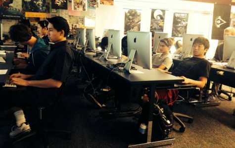 Students work diligently on web projects.