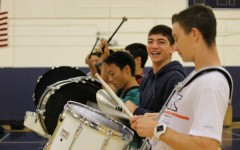 Drumline members have fun as they practice for their upcoming performances.