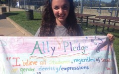 President Segal holds the banner from last year's Ally Week.