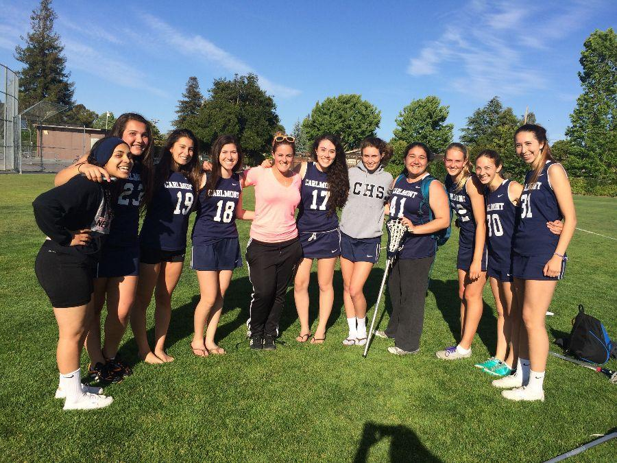 Members+of+the+first+Carlmont+girls+lacrosse+team+pose++after+their+last+game+of+the+season.