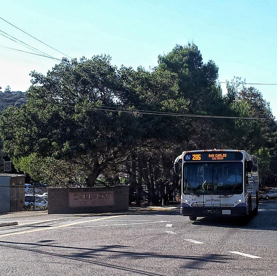 a SamTrans bus closing near Carlmont High School.
