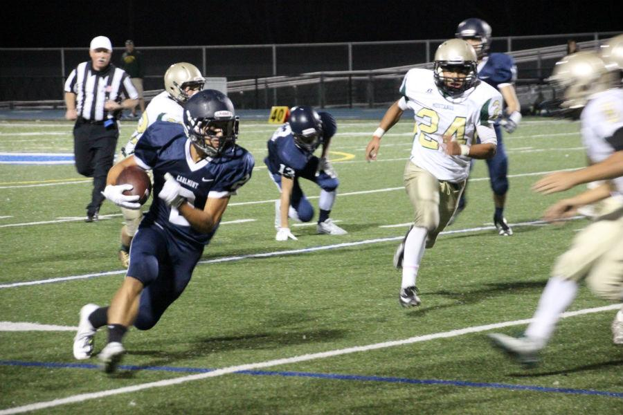 Running back Sami Makaafi sprints down the field, looking for the best way to advance the ball.