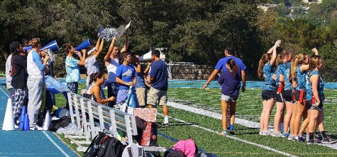For the third year in a row, the team of the current junior class reigned champion in Powderpuff football. The male cheerleaders encourage their team to victory in their first match against the freshmen.