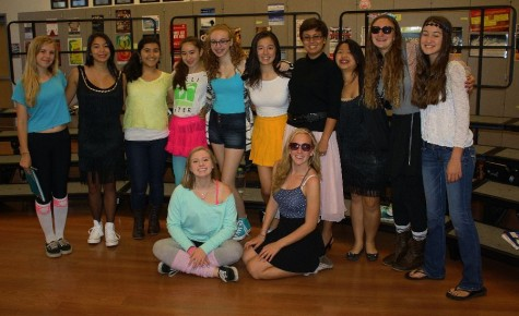 The ladies of Treble Clef show their spirit with outfits from many different times on Decades Day.