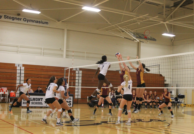 Junior Alexis Morrow, number seven, makes a kill on M-A.