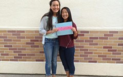 Feminist Club members, Sophomores Evelyn Lawrence and Sydney Pon, hold up the equality sign.