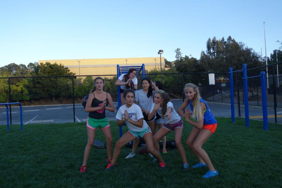 The Sophomore Powder Puff team strikes a pose after practice