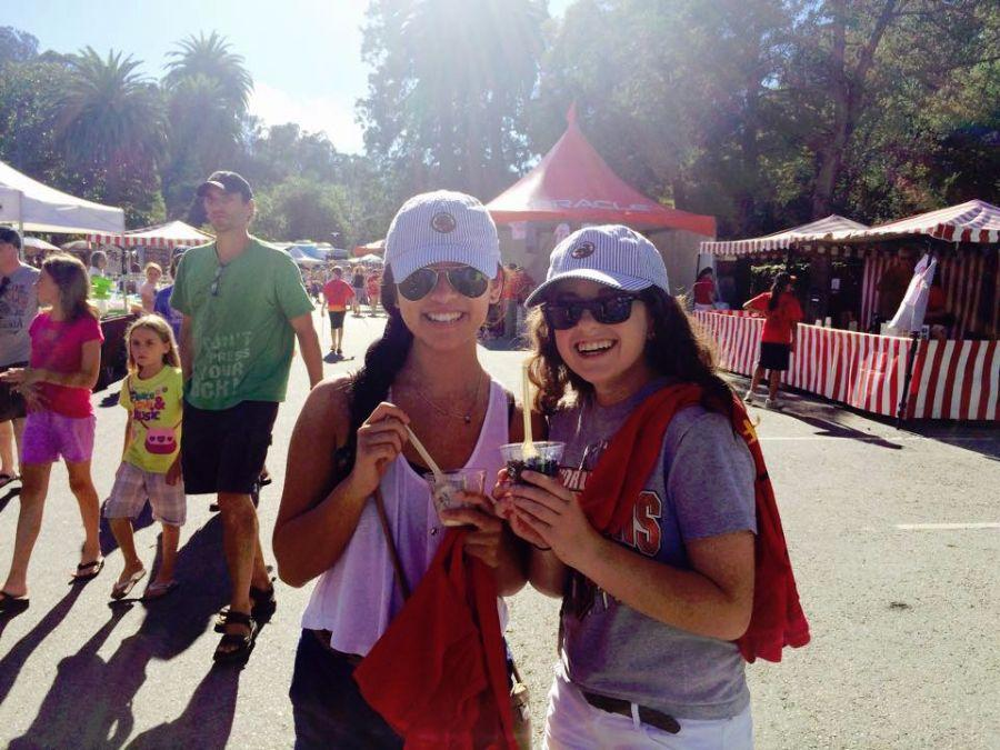 Seniors Adelyn Yau and Amanda Breslauer enjoy frozen custard outside the food trucks at Save the Music.