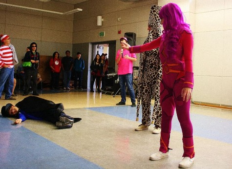"""Senior Sydney Salzman, dressed as Lavagirl, shows off her costume by """"melting"""" another student."""