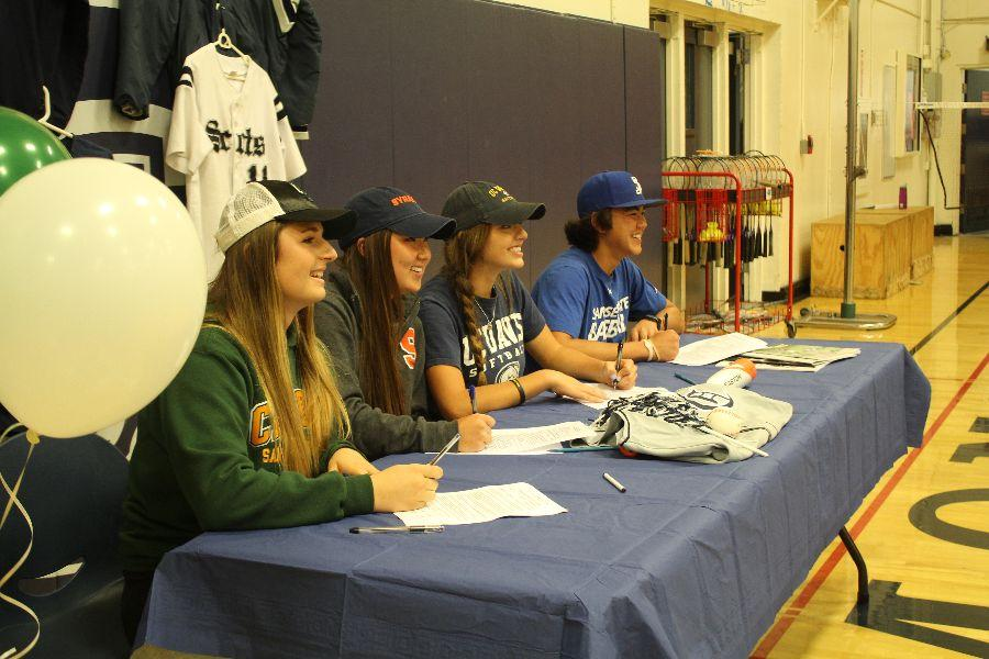 Seniors Kirra Loucks, Mariko Kondo, Sara Cadona, and Aaron Pleschner sign their NLI commitment letters to college.