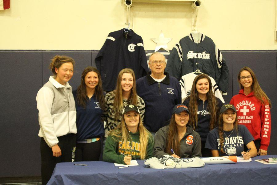 Members of the softball program join in for a picture.