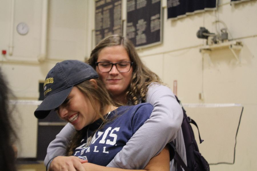 Senior Kristen Denney and Cadona are all giggles after the signing.