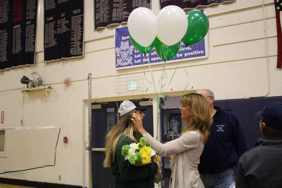 Parent Jennifer Loucks surprises Loucks with Cal Poly themed balloons and flowers.