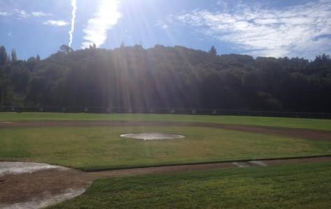 The sun shines down on the baseball field.