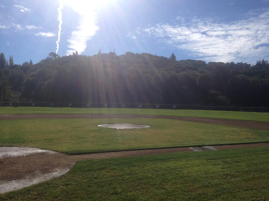 The+sun+shines+down+on+the+baseball+field.