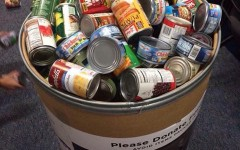 Cans overflow out of the bin in the ASB room
