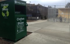 You can find the green bin near the pool and bike racks