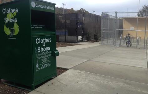 You can find the green bin near the pool and bike racks