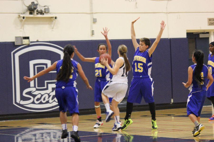Junior Ahna Kay attempts to make a shot as Jefferson players press her.