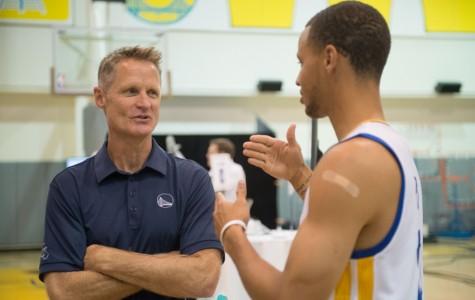 Head coach Steve Kerr talks strategy with superstar Stephen Curry