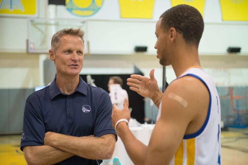 Head coach Steve Kerr talks strategy with superstar Stephen Curry