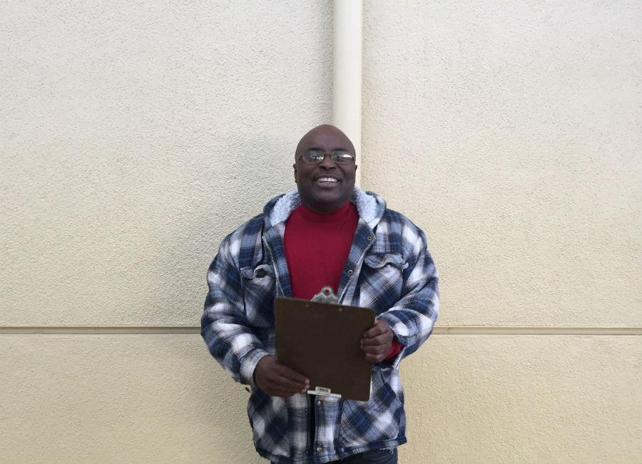 Plant manager Jerome Harris poses with his clipboard after getting out of a meeting.