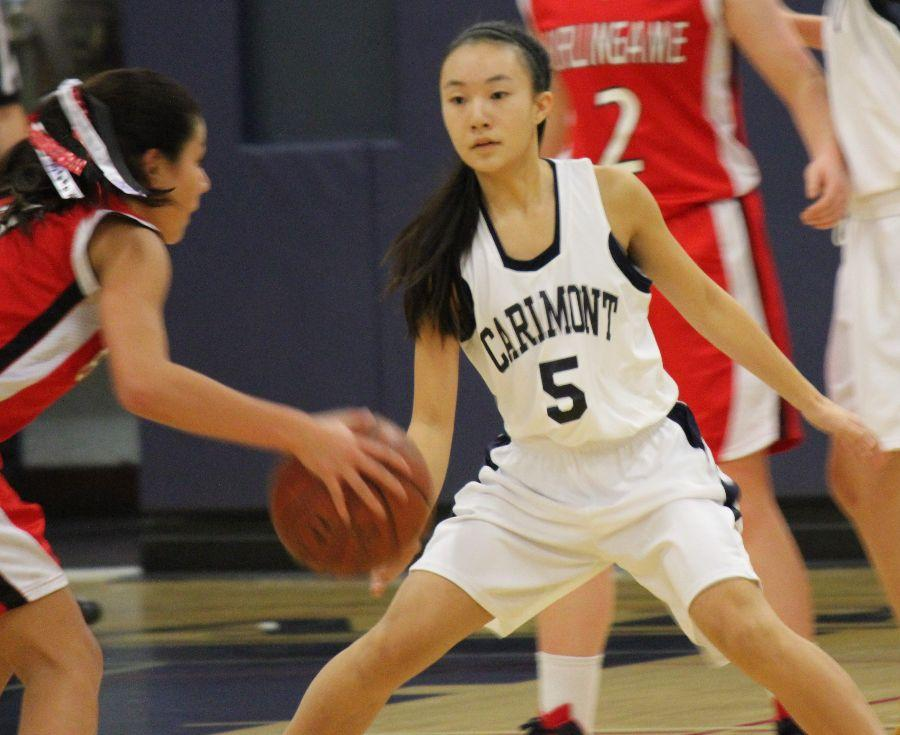 Mikayla+Fong+gets+low+as+she+braces+herself+to+defend+against+Burlingame%27s+attack.