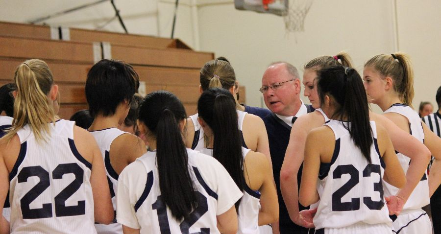 Head+Coach+Eric+Caslow+motivates+the+team+after+falling+behind+in+the+first+half.+%22We+talked+about+going+out+strong+in+the+second+half+and+playing+our+version+of+basketball%2C+to+play+Carlmont+basketball.+And+we+did+just+that.+We+got+in+a+good+groove+and+put+it+all+out+on+the+court%2C%22+said+Dirstine.