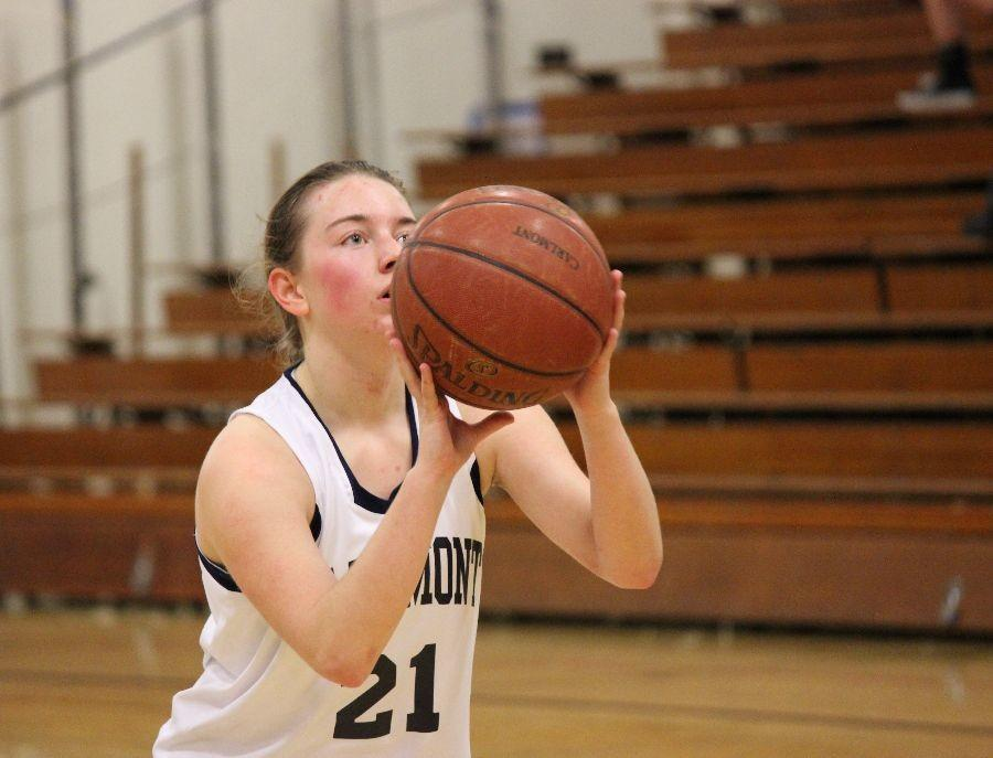 A+focused+Caitlin+Caslow+clears+her+head+as+she+prepares+to+take+a+free+throw.