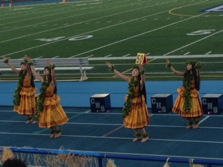 Makayla Fong, Kiana Edwards, Kiana Isono, and Noelani Edwards dance at a Carlmont football game.