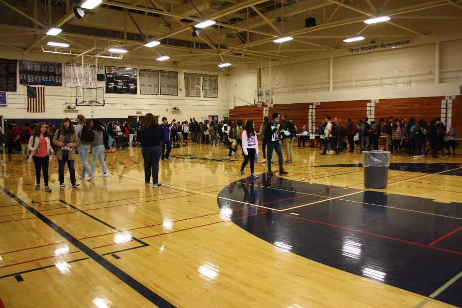 Students crows the gym at the course fair.