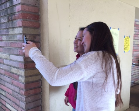 Sophomores Jill Patrucco and Brittany Cheung take a selfie for a Snapchat.
