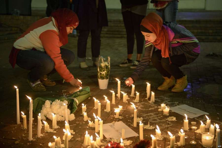 People mourn the death of three Muslim students following a vigil  at the University of North Carolina.