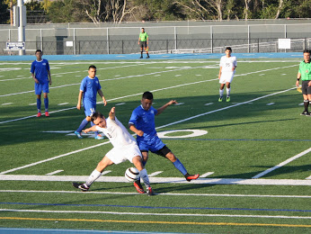 Junior Bijan Khalili fights for the ball against a South City defender.