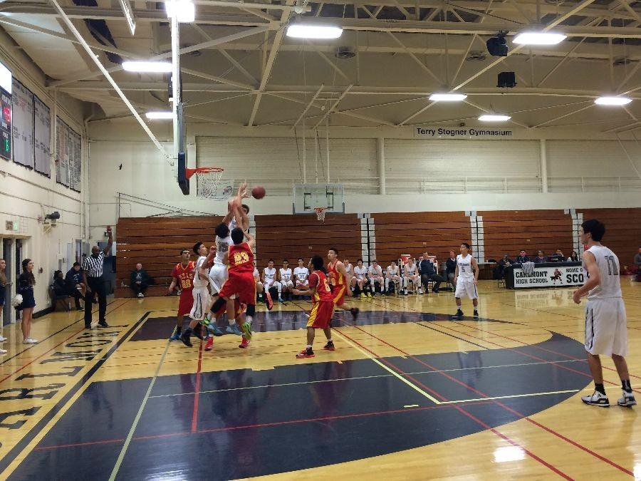 Players fighting for the rebound in the final quarter of the game.