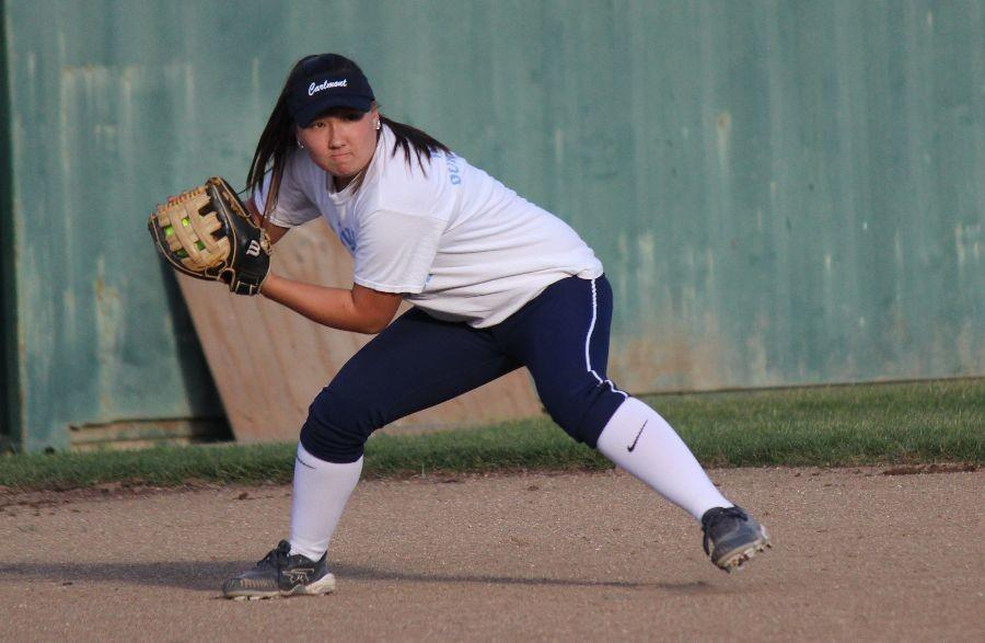 Mariko+Kondo%2C+a+senior+and+captain+on+varsity+softball%2C+scoops+up+the+ball+at+shortstop+and+looks+to+throw+it+to+second+base+for+the+out.+%22I%27m+looking+forward+to+getting+to+know+all+my+younger+teammates+and+to+really+come+together+on+the+field%2C%22+said+Kondo%2C+who+will+be+playing+softball+at+Syracuse+University+next+fall.