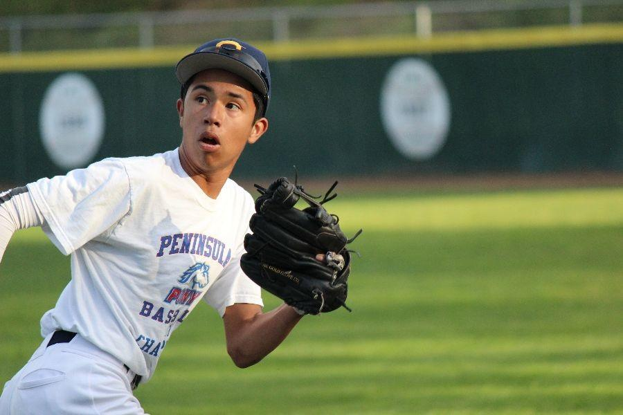 Outfielder Josef Gonzalez, a freshman, checks his shoulder while running back to catch a fly ball.