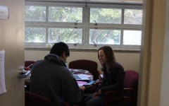 Counselor Kristin Vernon meets with a student to talk about college options.